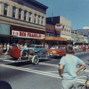 The Yard Birds sponsored dragster being towed on a trailer during a parade in Centralia, WA